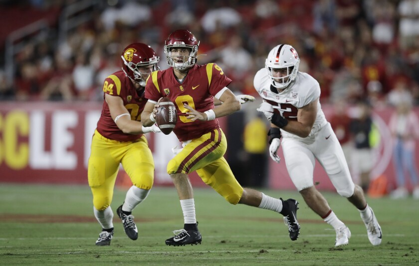 USC quarterback Kedon Slovis carries against Stanford during the first half on Sept. 7, 2019, at the Coliseum.