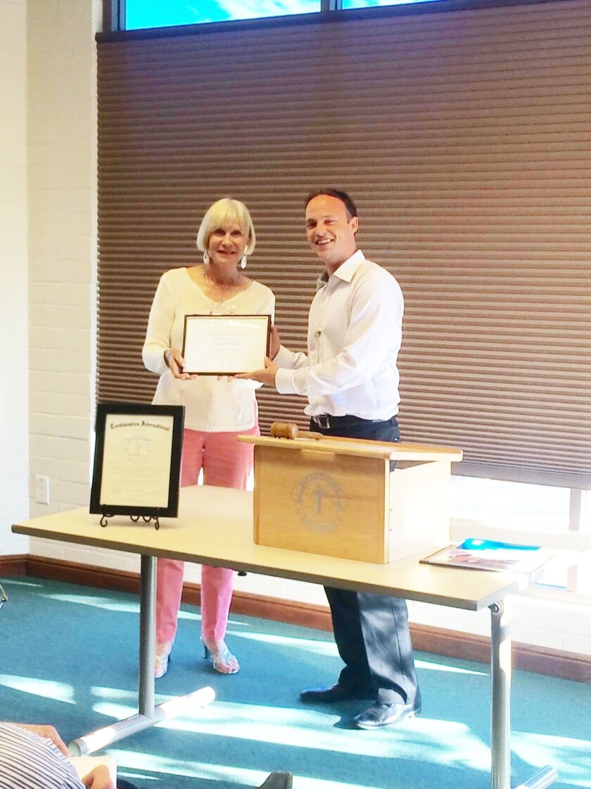 Toastmaster Roz Odmark recently received her Competent Communicator award presented by Dale Sodergren. Courtesy photo