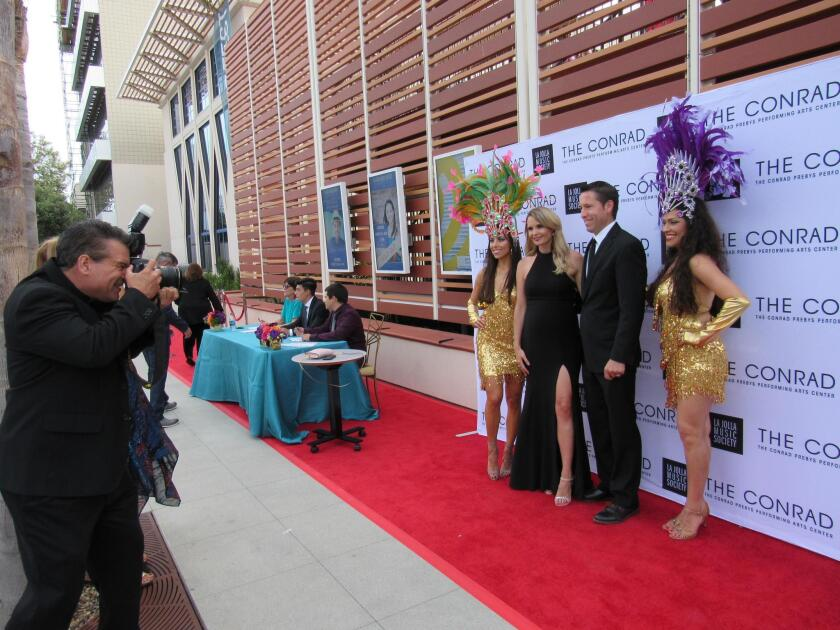 Patrons are photographed as they enter the SummerFest Gala.