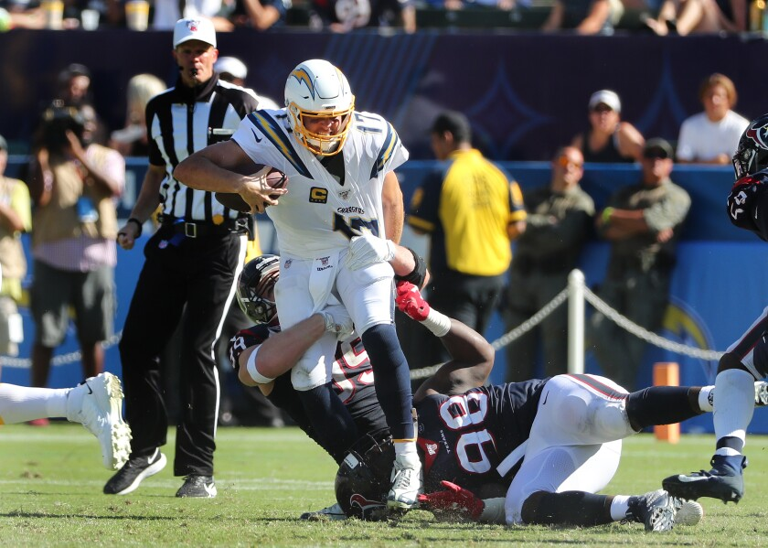 Chargers quarterback Philip Rivers is sacked by Houston Texans defensive end J.J. Watt.