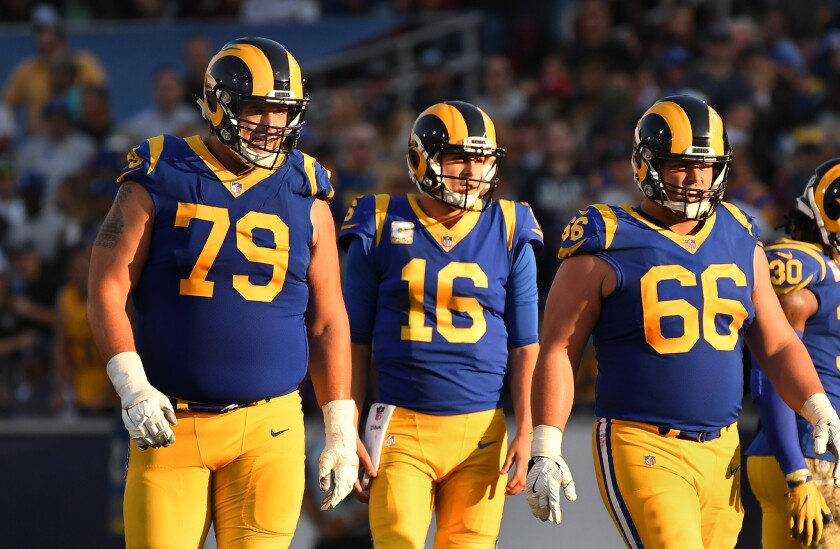 LOS ANGELES, CALIFORNIA NOVEMBER 11, 2018-Rams tackle Rob Havenstein (79) stands with Rams quarterba