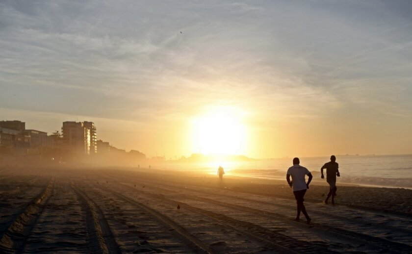 These early morning joggers in Brazil aren't just benefiting from burning calories. A new study suggests that exposure to morning light helps maintain a healthy BMI.