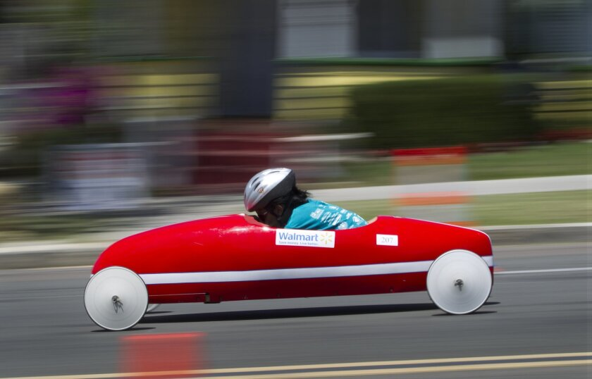 A young racer taking part in the All-American Soap Box Derby, makes their way down the race course.