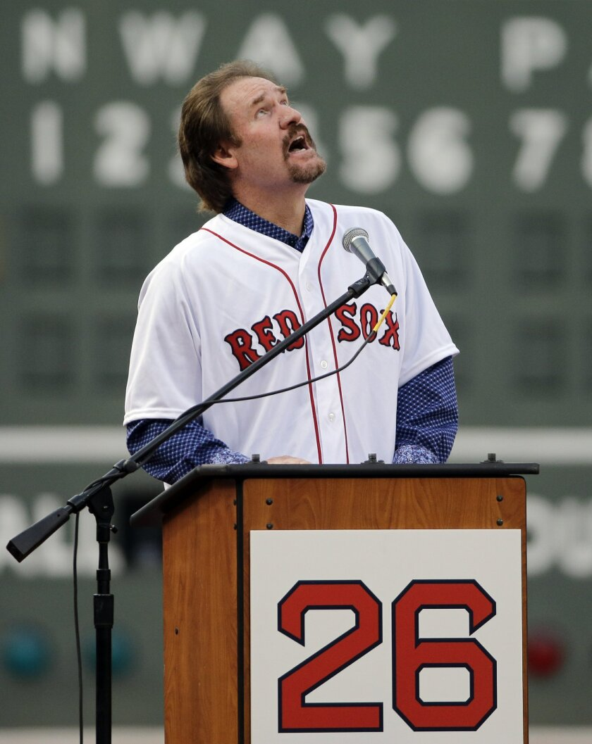 Former Boston Red Sox baseball player Wade Boggs looks skyward as he speaks during the retirement of his jersey No. 26 during a ceremony at Fenway Park, Thursday, May 26, 2016, in Boston, before a baseball game between the Red Sox and the Colorado Rockies. (AP Photo/Elise Amendola)