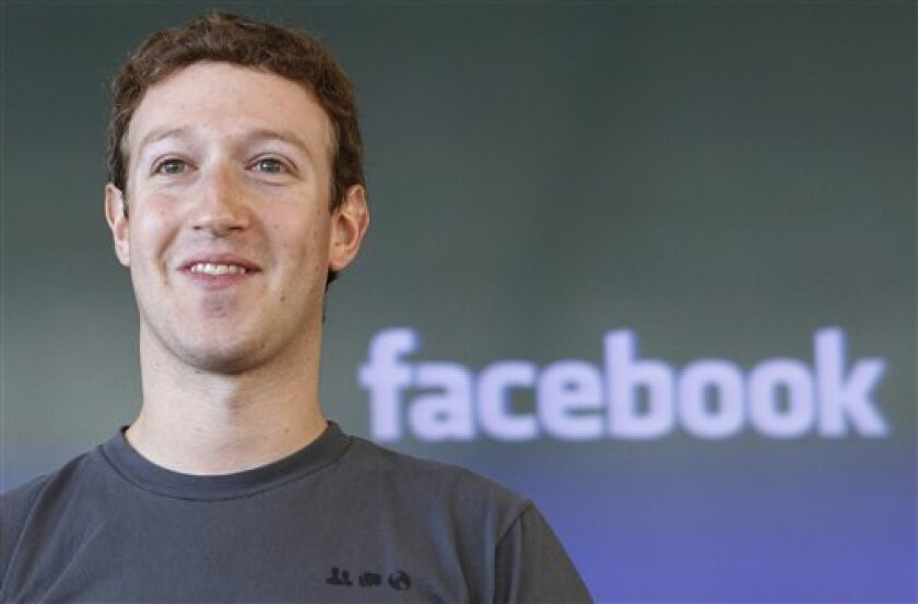 FILE - This Oct. 15, 2011 file photo shows Facebook CEO Mark Zuckerberg during a meeting in San Francisco. A New York man who claims he and Zuckerberg made a deal nine years ago that entitles him to half-ownership of the social networking giant won't be allowed to question Zuckerberg or search his