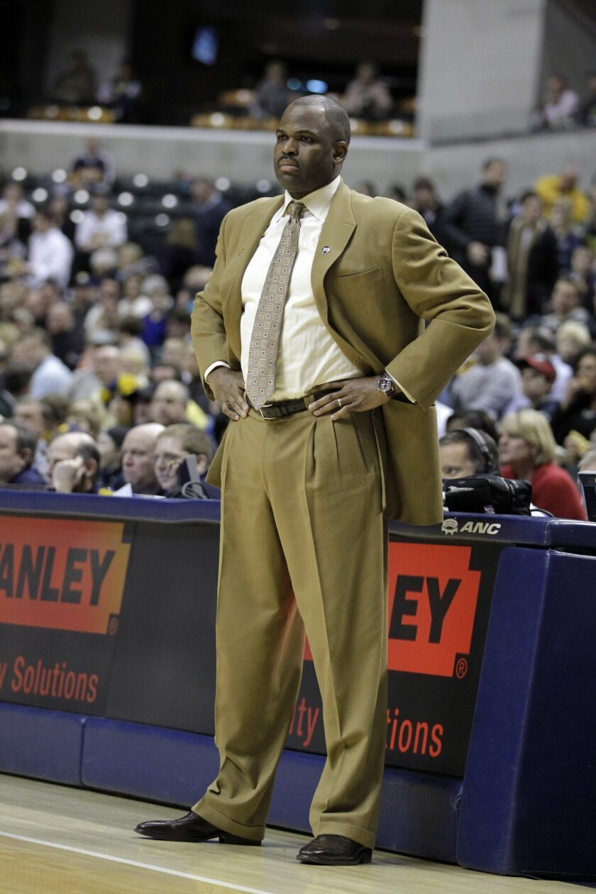 FILE - In this Feb. 4, 2011, file photo, then-Portland Trail Blazers head coach Nate McMillan looks on against the Indiana Pacers in the first half of an NBA basketball game in Indianapolis. On Monday, May 16, 2016, Pacers team president Larry Bird promoted the 51-year-old McMillan to head coach in