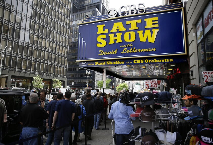 """A crowd gathered Wednesday outside the theater where David Letterman's last """"Late Show"""" was to be taped."""