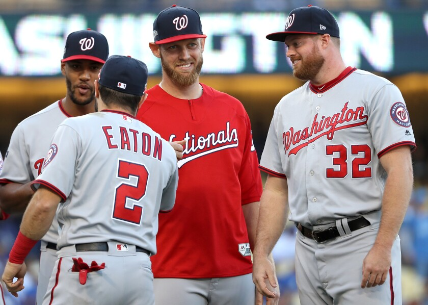 Nationals pitcher and San Diego State standout Stephen Strasburg, in red, has adjusted his approach to produce one of the best seasons in his 10-year career.