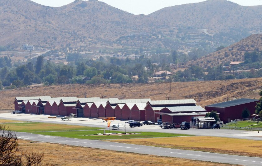 Agua Dulce Airpark, a small, rural airport in Agua Dulce, Calif., in northern Los Angeles County, is seen Wednesday, July 6, 2016. Fire officials say a stuntman was seriously injured Wednesday when he was pinned underneath a vehicle while filming. Los Angeles County Fire Inspector Richard Licon sai