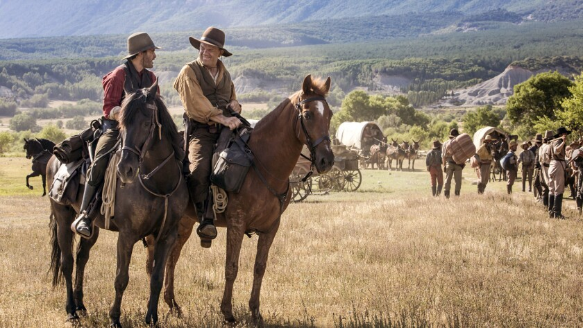 This image released by Annapurna Pictures shows Joaquin Phoenix, left, and John C. Reilly in a scene