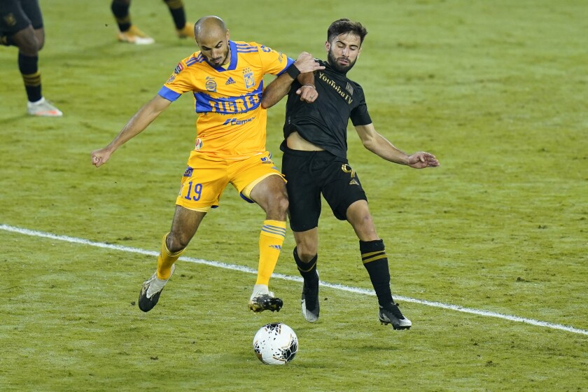 Tigres midfielder Guido Pizarro and LAFC forward Diego Rossi compete for possession of the ball.