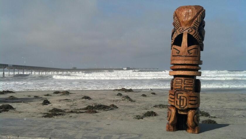 Ocean Beach artist Patrick Sousa adds his own element to tiki carvings. (Courtesy photo)