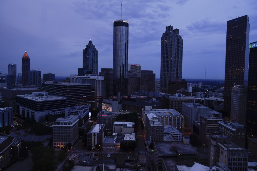Clouds roll into downtown Atlanta on Wednesday, Aug. 11, 2021, in Atlanta. The Census Bureau has issued its most detailed portrait yet of how the U.S. has changed over the past decade. The agency on Thursday released a trove of demographic data that will used to redraw political maps across an increasingly diverse country. (AP Photo/Brynn Anderson)