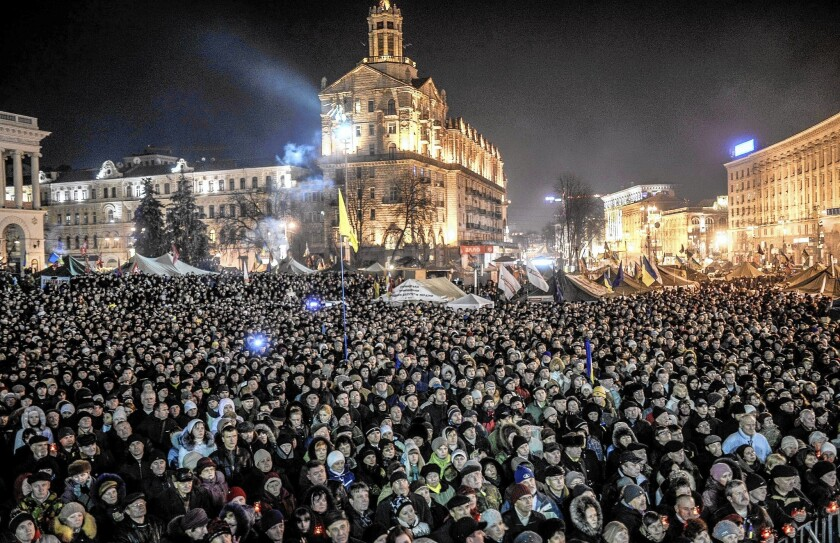 """A crowd waits in Kiev's Independence Square to hear the names of the new Cabinet members. """"There is not a single name on the list associated in any way with Yanukovich's regime,"""" said analyst Igor Popov."""