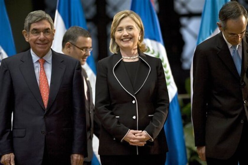 U.S. Secretary of State Hillary Rodham Clinton, center, laughs next to Costa Rica's President Oscar Arias, left, and Guatemala's President Alvaro Colom while waiting to have an official photo taken at the presidential palace in Guatemala City, Friday, March 5, 2010. Clinton is on a one-day official visit to Guatemala. (AP Photo/Rodrigo Abd)
