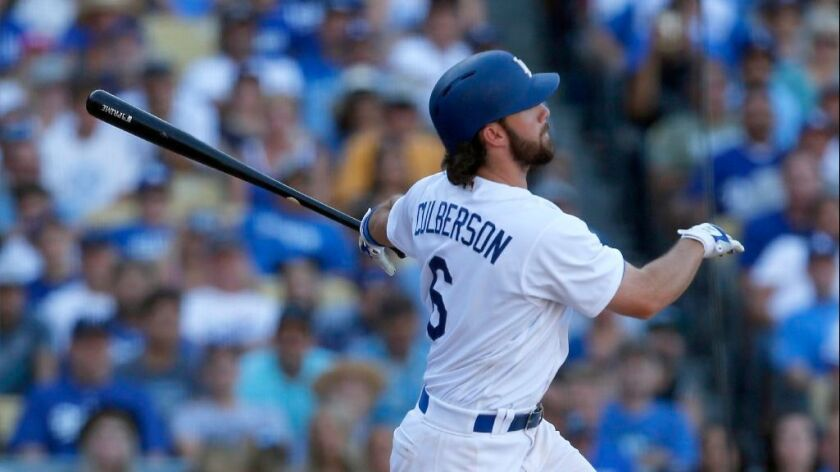 Dodgers seond baseman Charlie Culberson watches the trajectory of walk-off home run against the Rockies in the tenth inning of a game on Sept. 25.