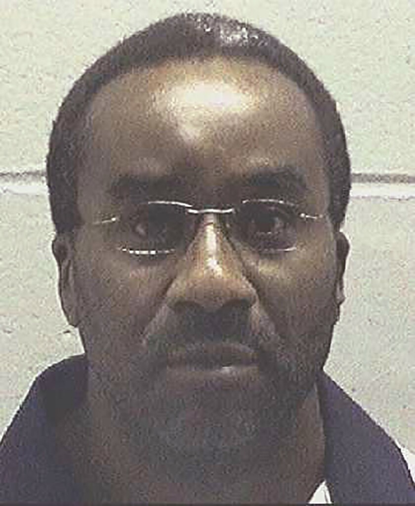 In this undated photo made available by the Georgia Department of Corrections, inmate Ray Jefferson Cromartie is in custody. Georgia Attorney General Chris Carr said in a news release Wednesday, Oct. 16, 2019, that 52-year-old Cromartie is scheduled to die Oct. 30. Cromartie was convicted in the April 1994 slaying of Richard Slysz at a convenience store in Thomasville, just north of the Florida border. (Georgia Department of Corrections via AP)