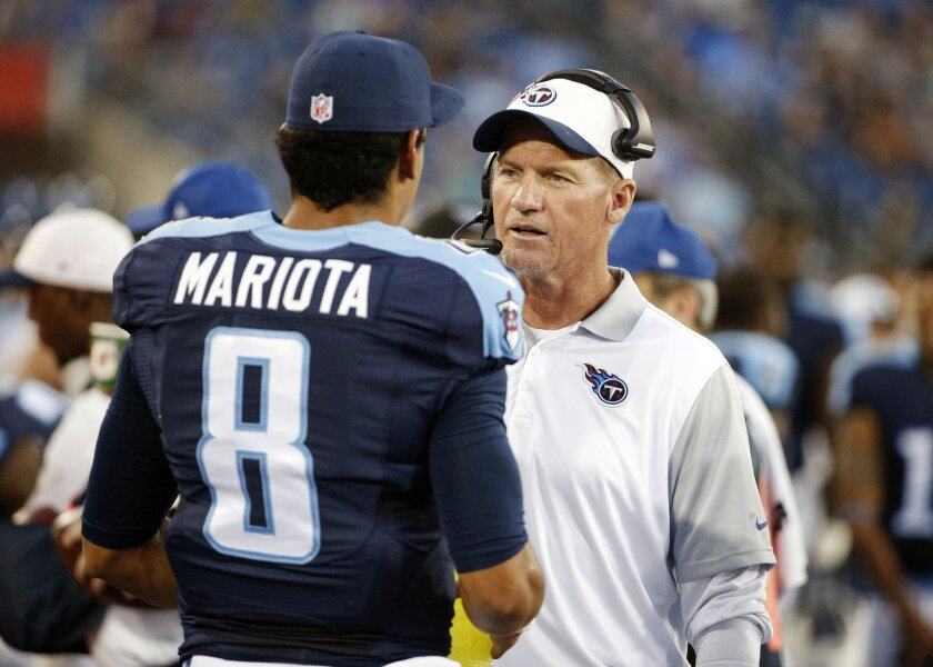 FILE - In this Sept. 3, 2015, file photo, Tennessee Titans head coach Ken Whisenhunt talks with quarterback Marcus Mariota (8) in the first half of a preseason NFL football game against the Minnesota Vikings, in Nashville, Tenn. With 21 teams not owning winning records through eight weeks, it's no