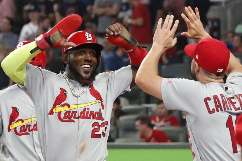 St. Louis Cardinals left fielder Marcell Ozuna (23) celebrates his two RBI single against the Atlanta Braves in the ninth inning during Game 1 of a best-of-five National League Division Series, Thursday, Oct. 3, 2019, in Atlanta. (AP Photo/John Bazemore)