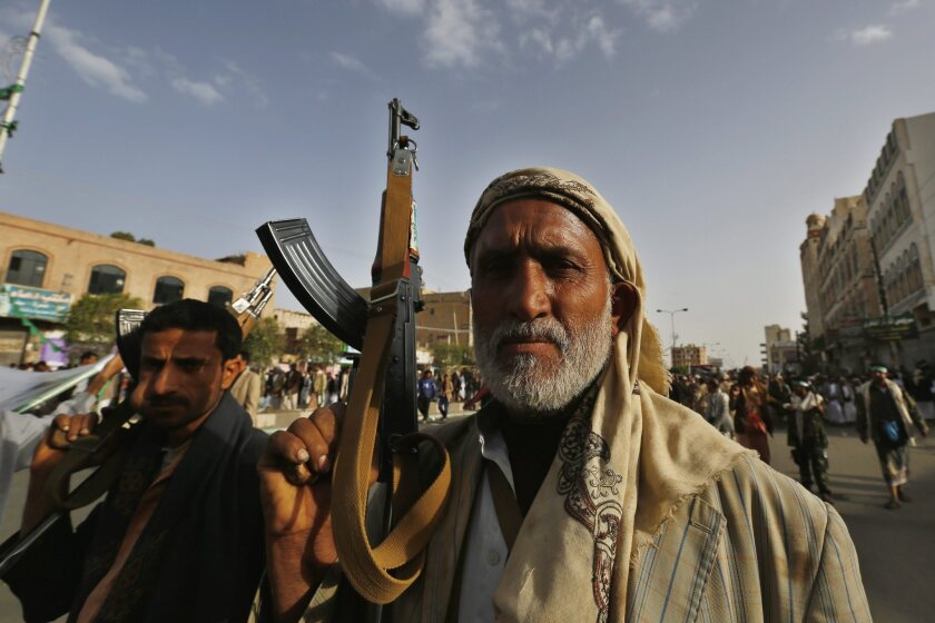 Houthi supporters carry weapons during a protest against airstrikes carried out by a Saudi-led coalition against Houthi positions in Sana, Yemen, on April 10.