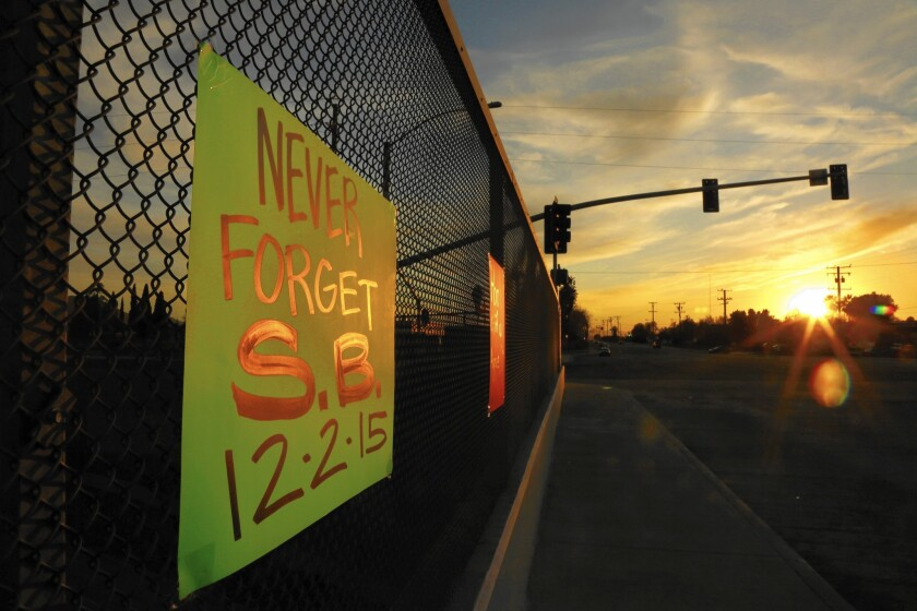 One of several signs supporting the city of San Bernardino hangs above the 215 Freeway on Dec. 6.