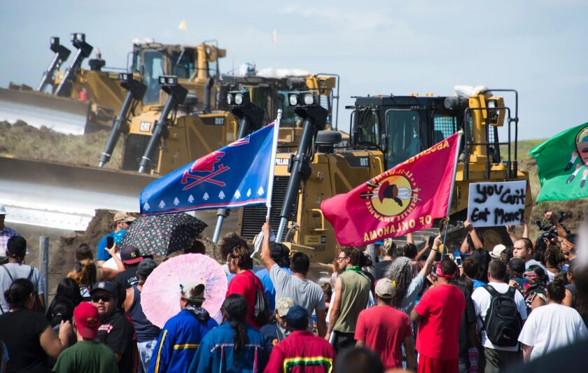 Members of the Standing Rock Sioux tribe and their supporters confront bulldozers working on the Dakota Access Pipeline near Cannon Ball, N.D.
