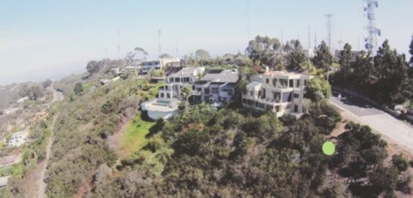 """The green dot in this photo shows the vacant Mt. Soledad hillside (1994 Via Casa Alta) where applicants are seeking to build a two-story, 4,843-square-foot home above a """"basement"""" (as defined by the city)."""