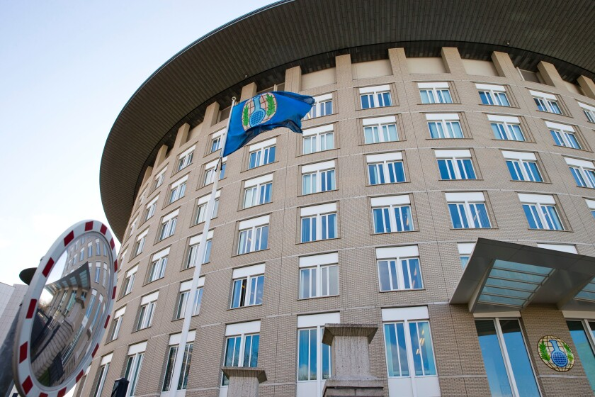 FILE - This Wednesday, March 21, 2018 file photo shows the headquarters of the Organization for the Prohibition of Chemical Weapons (OPCW) in The Hague, Netherlands. The global chemical weapons watchdog says that two investigations into alleged attacks in Syria in 2016 and 2018 couldn't establish that chemical weapons were used in either case. The Organization for the Prohibition of Chemical Weapons issued two reports Friday, Oct. 2, 2020 by its Fact-Finding Mission into attacks in Saraqib in the Idlib region on Aug. 1, 2016, and in Aleppo on Nov. 24, 2018. (AP Photo/Peter Dejong, File)