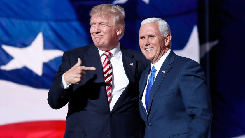 Donald Trump points toward Gov. Mike Pence of Indiana after Pence's speech at the Republican National Convention.