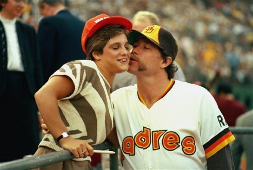 """In this Oct. 10, 1984 file photo, Olympic gymnast Mary Lou Retton gets a kiss from San Diego Padres reliever Rich """"Goose"""" Gossage before a World Series game against Detroit in San Diego."""