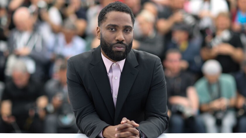 "John David Washington poses during a photocall for the film ""BlacKkKlansman"" at the 71st edition of the Cannes Film Festival."