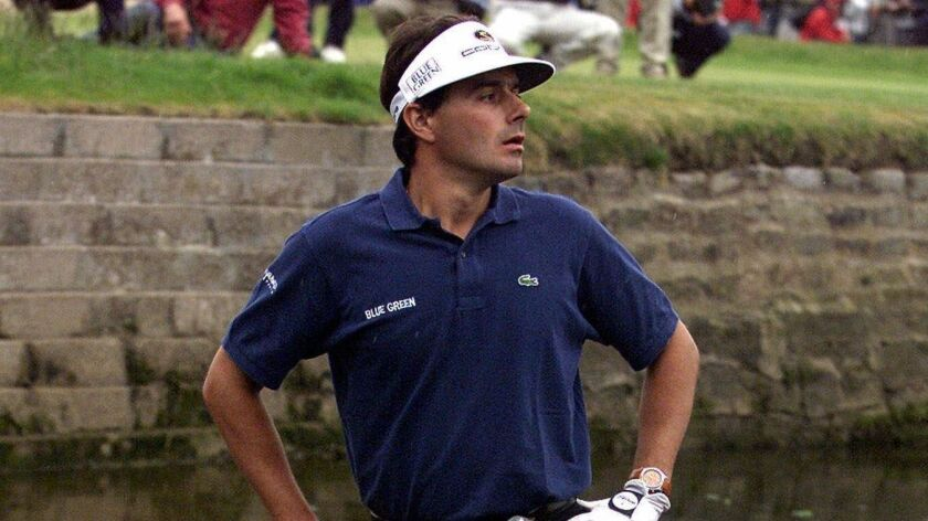 Jean Van de Velde looks on at the 72nd hole during the 1999 British Open at Carnoustie in Scotland.
