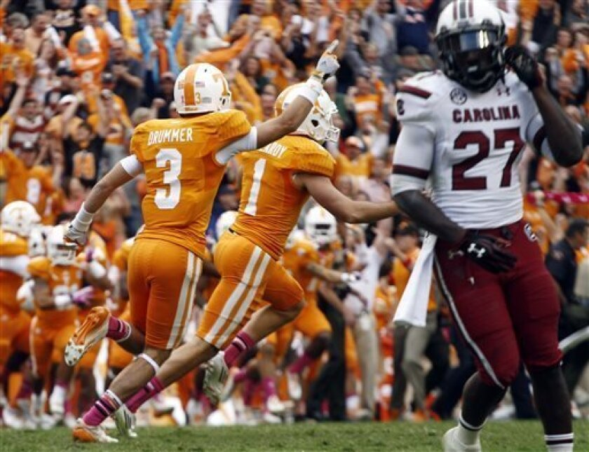 Tennessee kicker Michael Palardy (1) and wide receiver Tyler Drummer (3) celebrate their 23-21 victory over South Carolina after Palardy kick the game-winning field goal as time expired in an NCAA college football game against South Carolina on Saturday, Oct. 19, 2013, in Knoxville, Tenn. Tennessse