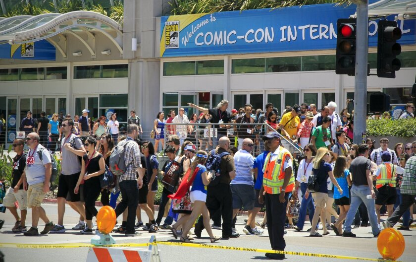 Crowds head for the San Diego Convention Center on the first day  of Comic-Con 2014.