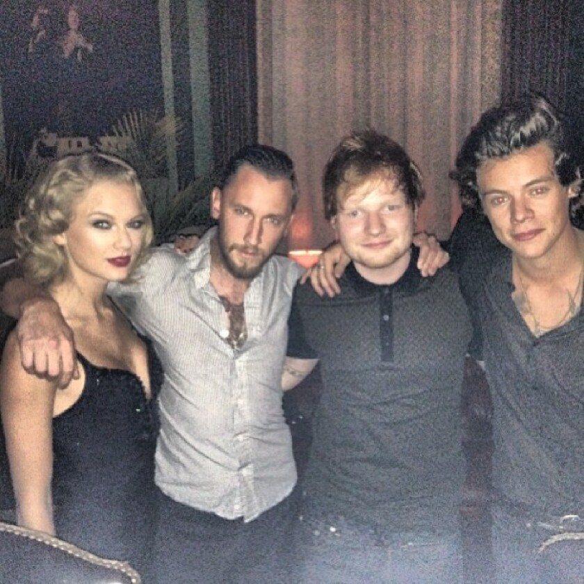 A photo posted on Instagram shows Taylor Swift, left, and her ex-boyfriend Harry Styles, far right, at a VMA after-party.
