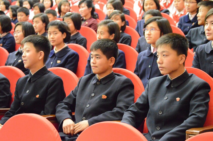 Young people wait for the show to start at North Korea's Children's Palace in Pyongyang.