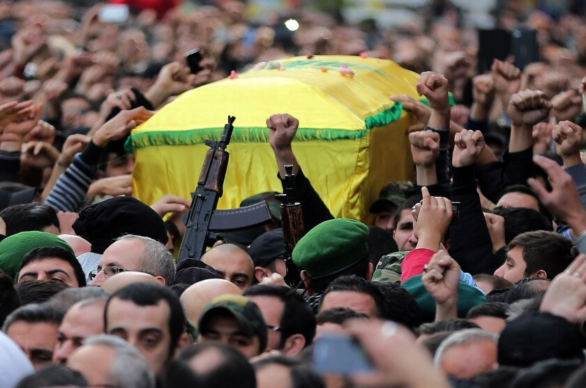 Lebanese Hezbollah supporters carry the coffin of militant Jihad Mughniyeh during his funeral in a southern Beirut suburb.