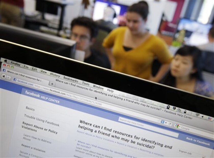 "This Dec. 13, 2011 file photo, shows workers inside Facebook headquarters in Menlo Park, Calif.Facebook, the social network that changed ""friend"" from a noun to a verb, is expected to file as early as Wednesday to sell stock on the open market. Its debut is likely to be the most talked-about initial public offering since Google in 2004. (AP Photo/Paul Sakuma, file)"