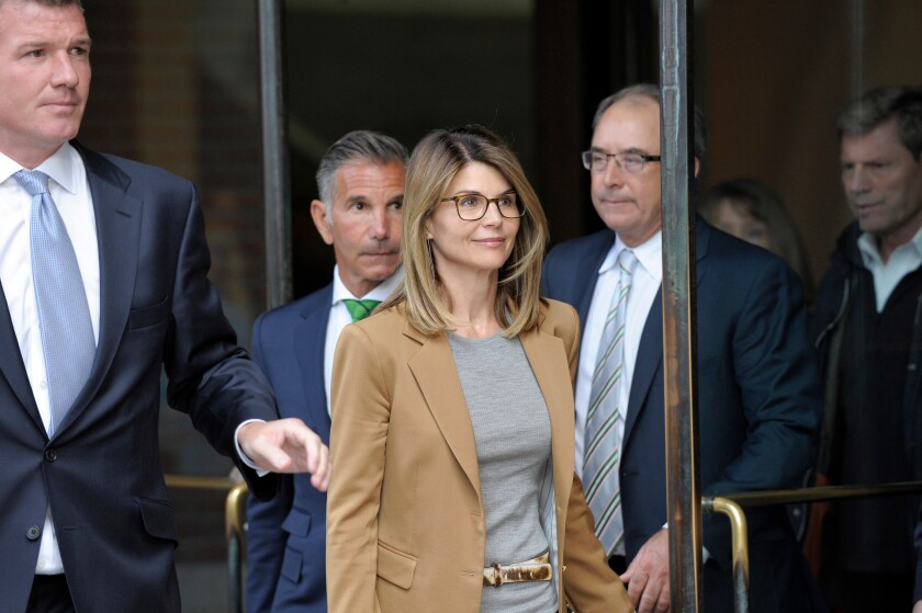 Actress Lori Loughlin exits the courthouse after facing charges for allegedly conspiring to commit mail fraud and other charges in the college admissions scandal at the John Joseph Moakley United States Courthouse in Boston.