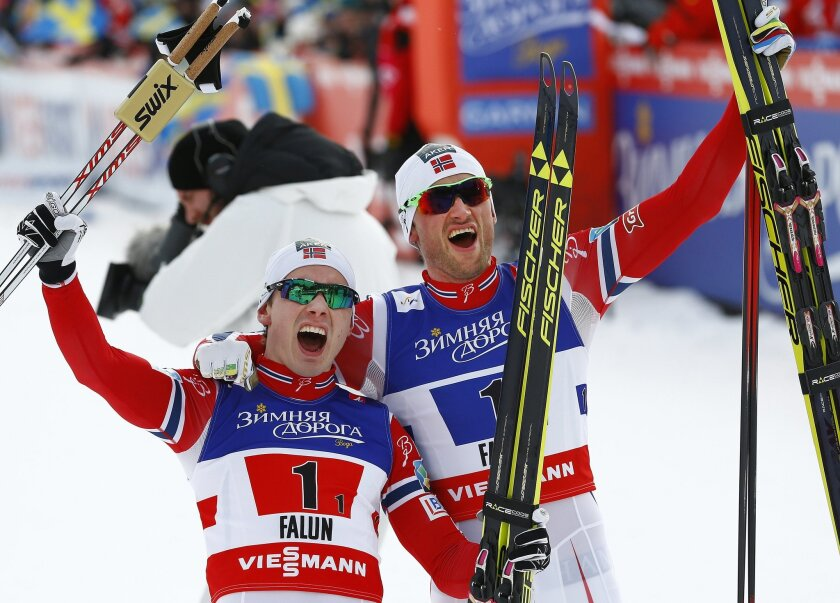 Norway's Petter Jr. Northug , right, and Norway's Finn Haagen Krogh celebrate after the Cross Country Team Sprint final at the Nordic Skiing World Championships in Falun, Sweden, Sunday, Feb. 22, 2015. (AP Photo/Matthias Schrader)