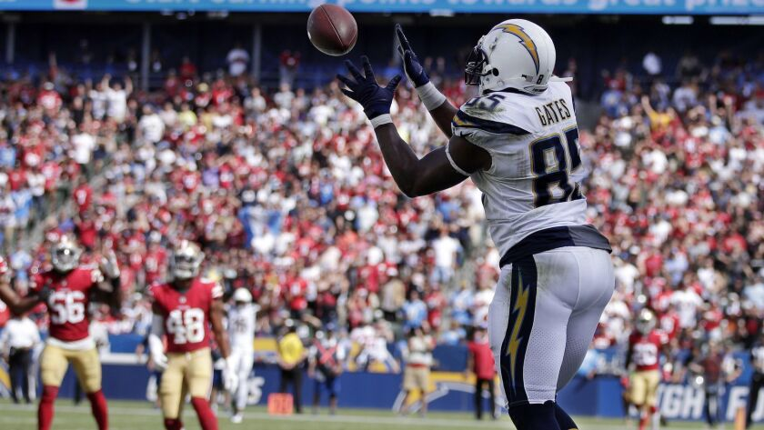 Chargers tight end Antonio Gates makes a touchdown catch against the 49ers during the first half Sunday.