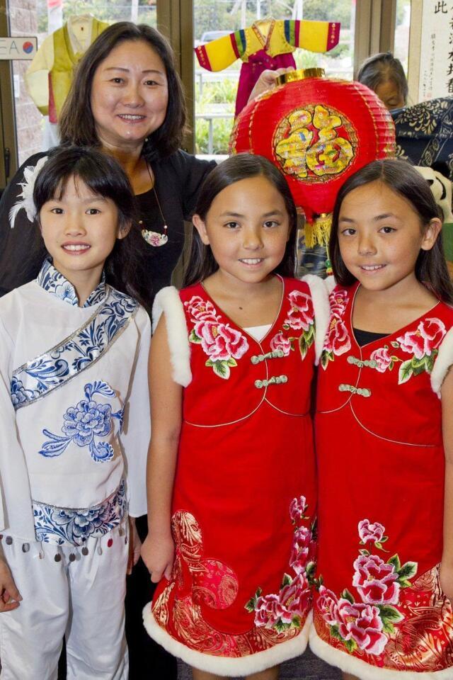 Angela Fu, Lucy Zhao, Nicole Salerno, Amy Salerno at the China table