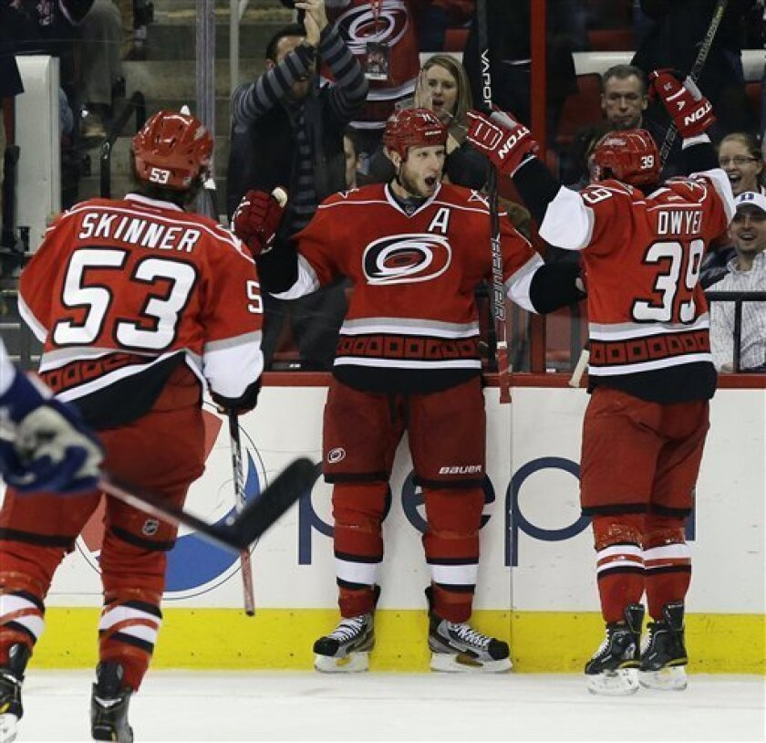 Carolina Hurricanes' Jordan Staal, center, celebrates his goal against the Toronto Maple Leafs with Jeff Skinner (53) and Patrick Dwyer, right, during the second period of an NHL hockey game in Raleigh, N.C., Thursday, Feb. 14, 2013. Carolina won 3-1. (AP Photo/Gerry Broome)