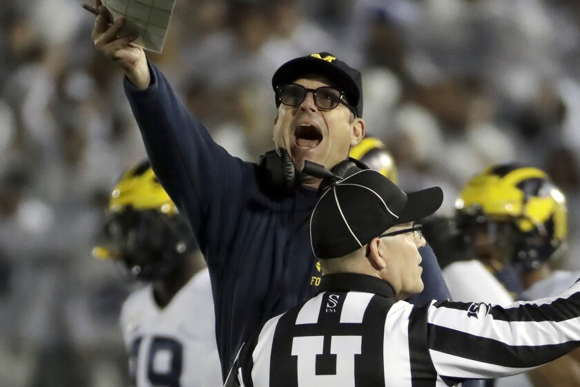Michigan coach Jim Harbaugh argues a call during the first half of the Wolverines' game against Penn State on Oct. 19 in State College, Pa.