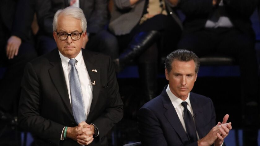 California gubernatorial candidates John Cox, left, and Lt. Gov. Gavin Newsom at a Jan. 25 debate at UCLA's Royce Hall.