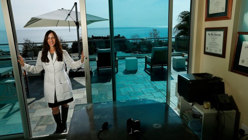 Dr. LIsa Benya of Cure is photographed at the entrance to her office in Malibu that has a deck outside overlooking the Pacific Ocean.