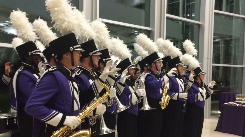 Members of the Northwestern band, after performing at tribute.