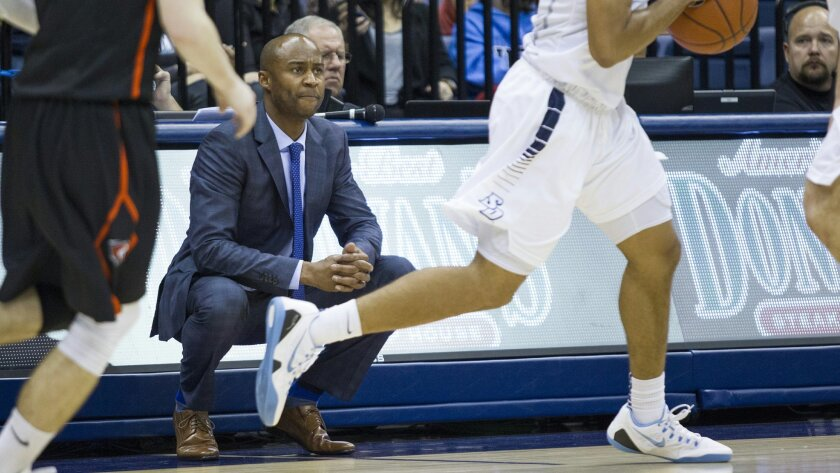 Basketball coach Lamont Smith will be working with a young roster this season.