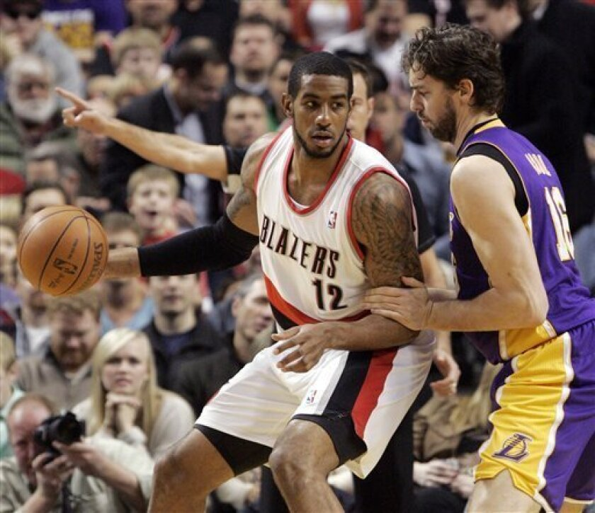 CORRECTS YEAR - Portland Trail Blazers forward LaMarcus Aldridge, left, backs in on Los Angeles Lakers forward Pau Gasol, from Spain, during the first half of an NBA basketball game in Portland, Ore., Thursday, Jan. 5, 2012. (AP Photo/Don Ryan)