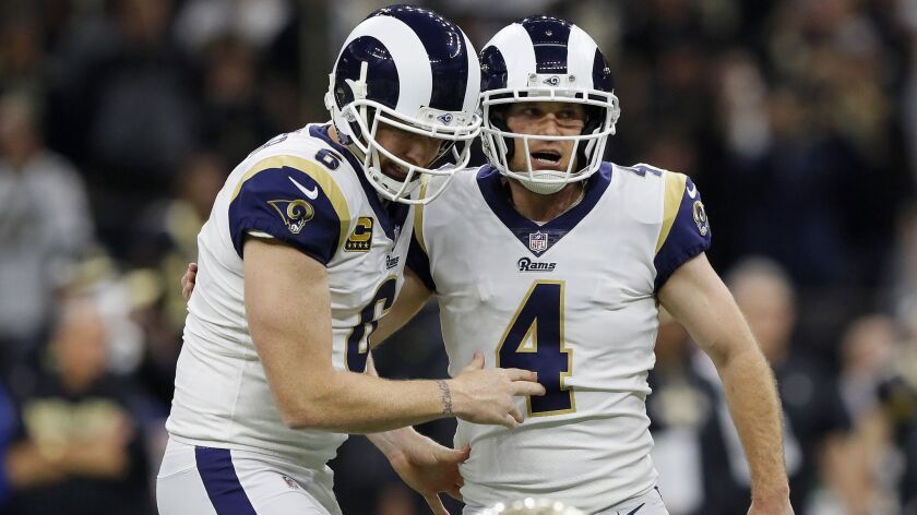 Rams kicker Greg Zuerlein (4) and punter Johnny Hekker celebrate after Zuerlein's field goal that tied the NFC Championship game and sent it to overtime.